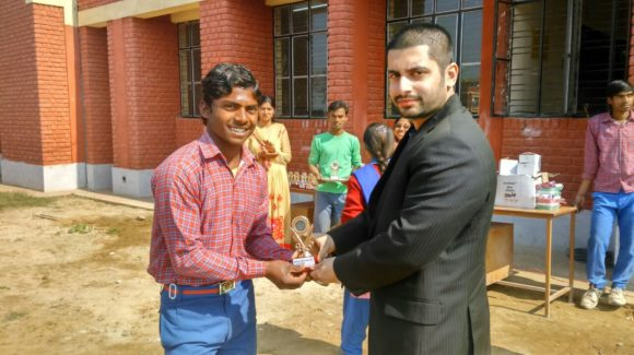 Dr. Arnab Distributing prizes at Daapalaya School