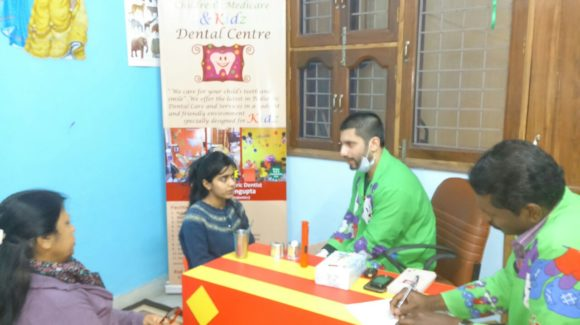 Dr. Arnab treating kids dental problems